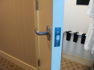 Open closet door with door handle and roller lock