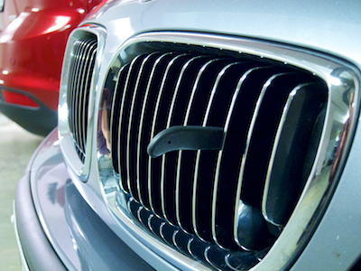 BMW car's front grille with a handle protruding from it