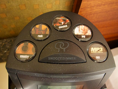 Radio station presets and snooze button on top of the clock