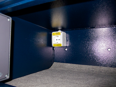 A standard (European) power socket mounted inside the hotel safe