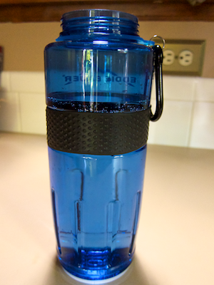 Water bottle filled to just above its rubber anti-slip band