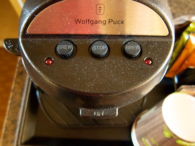 The coffee maker from above with three buttons on the top
