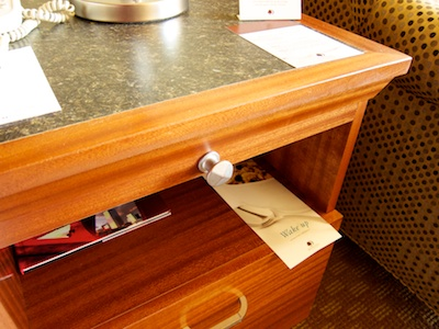 Night stand that, right below its top, features a knob that looks exactly like those on the TV console dresser