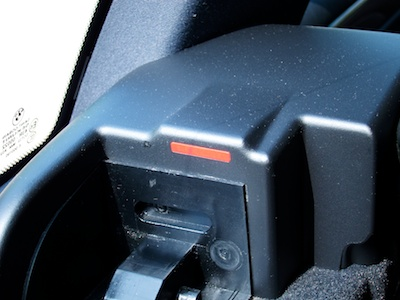 Trunk cover mounting bracket with a red bar on its inside surface.