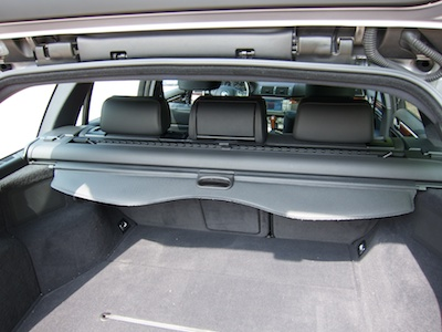 Station wagon's trunk with retracted trunk cover.